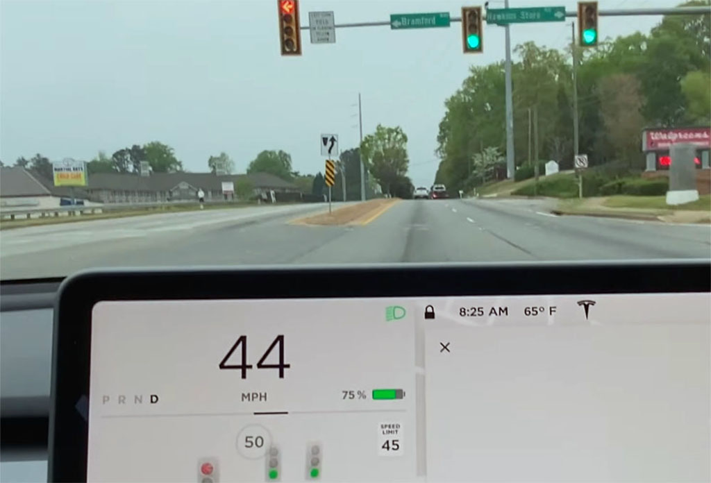 How can Tesla improve traffic light and stop sign control?